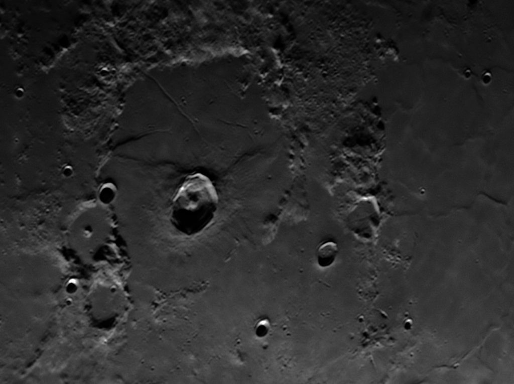 Lacus Mortis with Burg crater and easily visible Rimae Burg above
