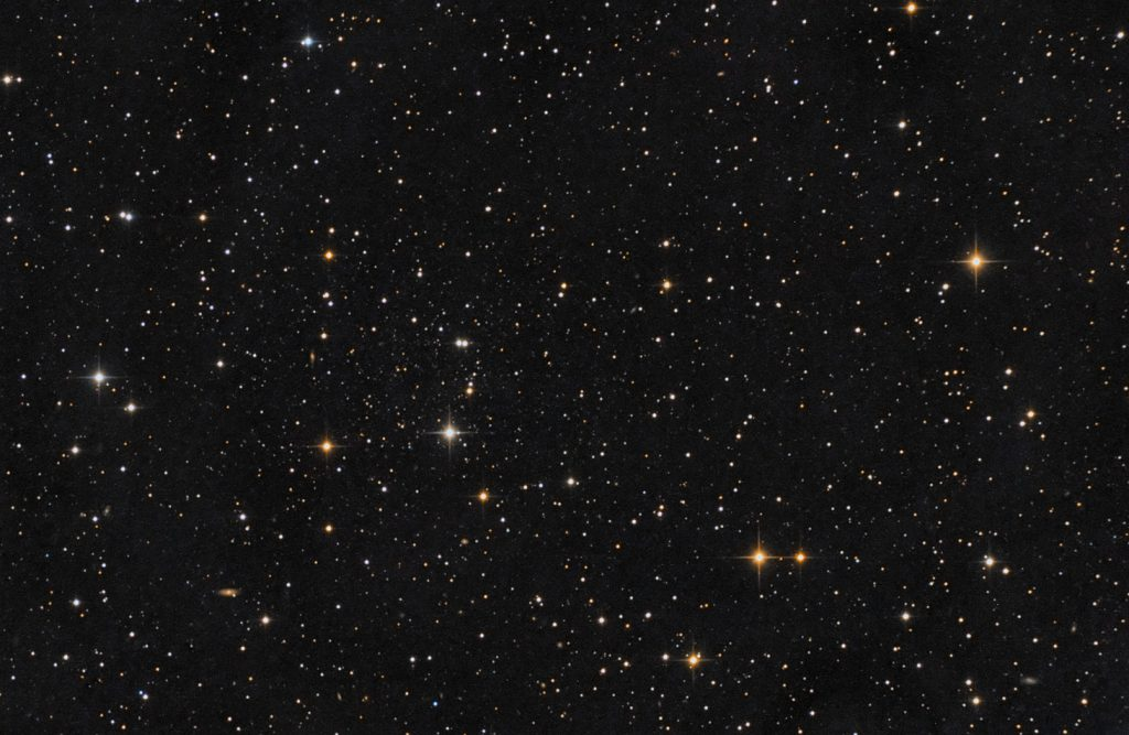 Draco Dwarf galaxy (loose star cluster to the left of frame center)