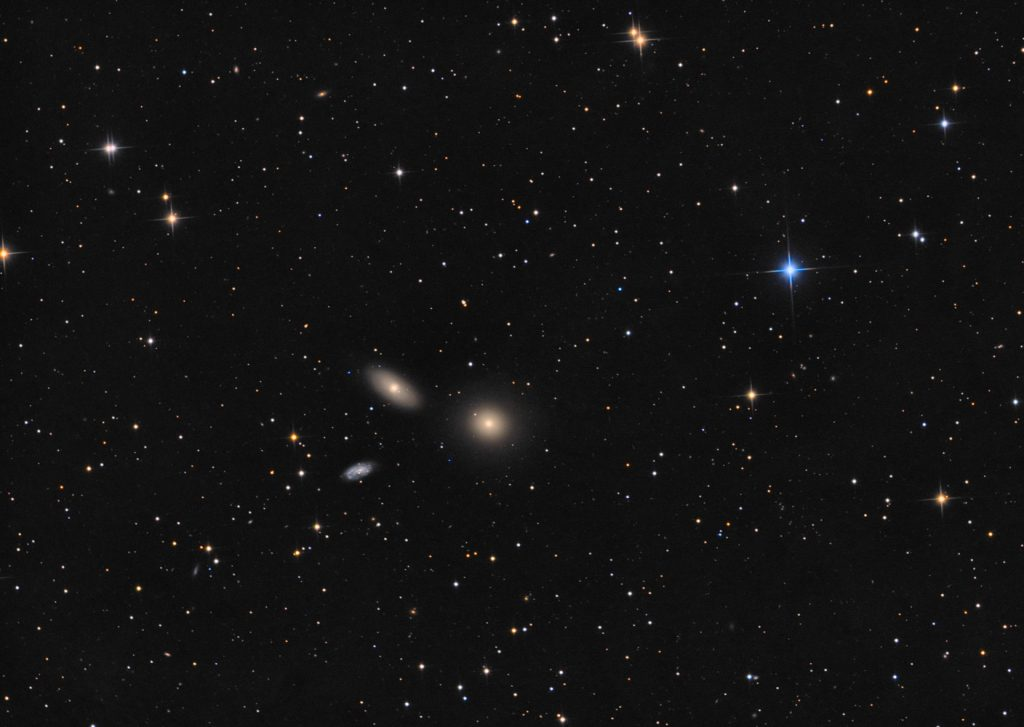 Yet another Leo triplet with M105 galaxy