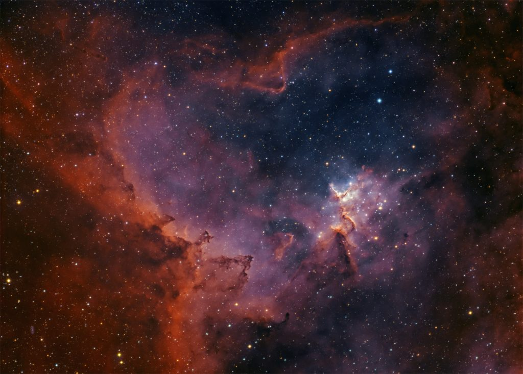 Melotte 15 star cluster in the centre of Heart nebula. Red color indicates hydrogen and blue is oxygen.