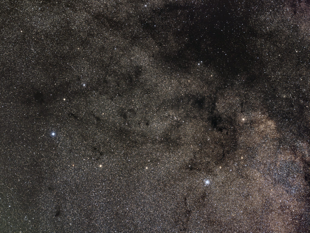 Dark nebulosity (with Barnard 111) around M11 Wild Duck cluster
