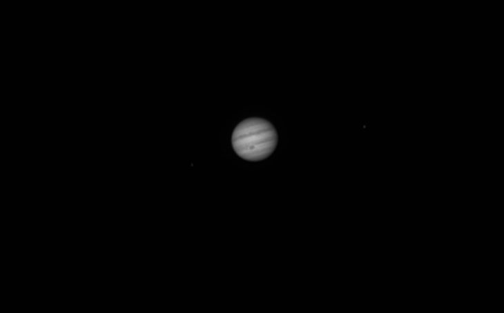 Jupiter with Io (left) and Ganymede (right)